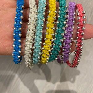 Multiple colourful bracelets